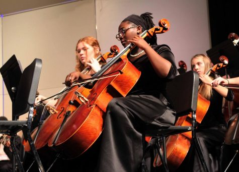 Warming up with her cello prior to the KHS Orchestra Concert, Keziah Smith, sophomore,  gets ready to perform for friends and family. Dec. 13.