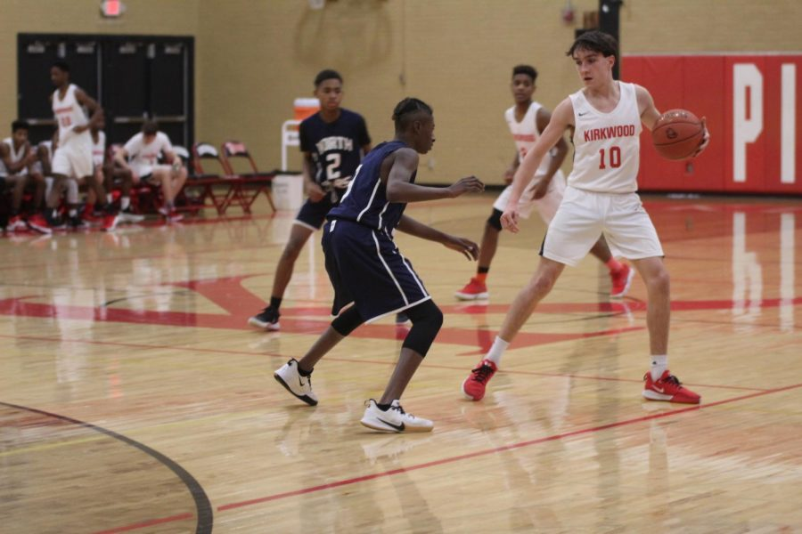 Holding the ball away from his opponent, Patrick Fortune, freshman, plays along with his team members against McCluer North.
