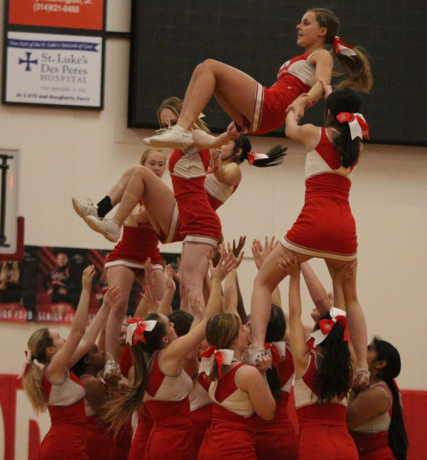 Kirkwood Varsity Cheer team performs at the boys varsity basketball game Jan. 14.