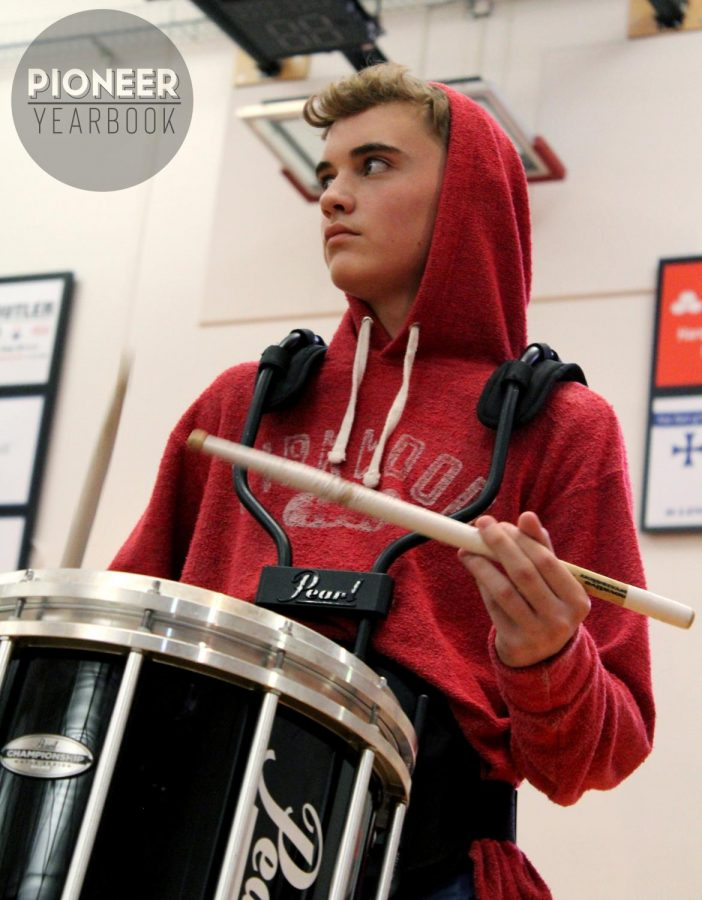 Performing in his first Turkey Day Pep Rally, Noel Musson, freshman, looks at the crowd.