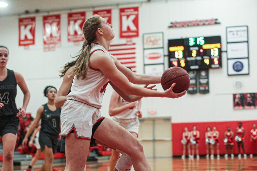 Going for a layup, Natalie Bruns, senior, makes the basket to create a two point lead for her team, Jan. 15.