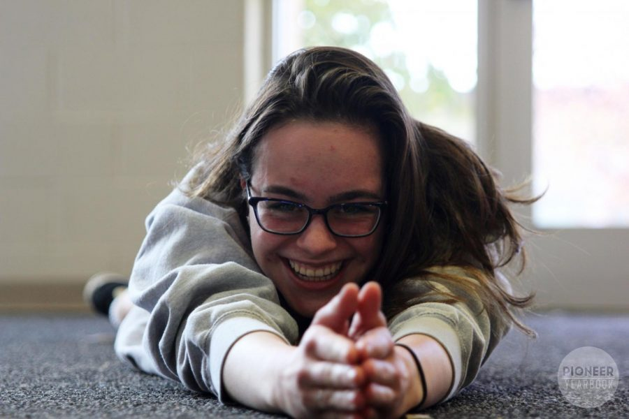 Falling on the ground, Joslynn Gura, sophomore, laughs at a joke her friend said during lunch Nov. 25.