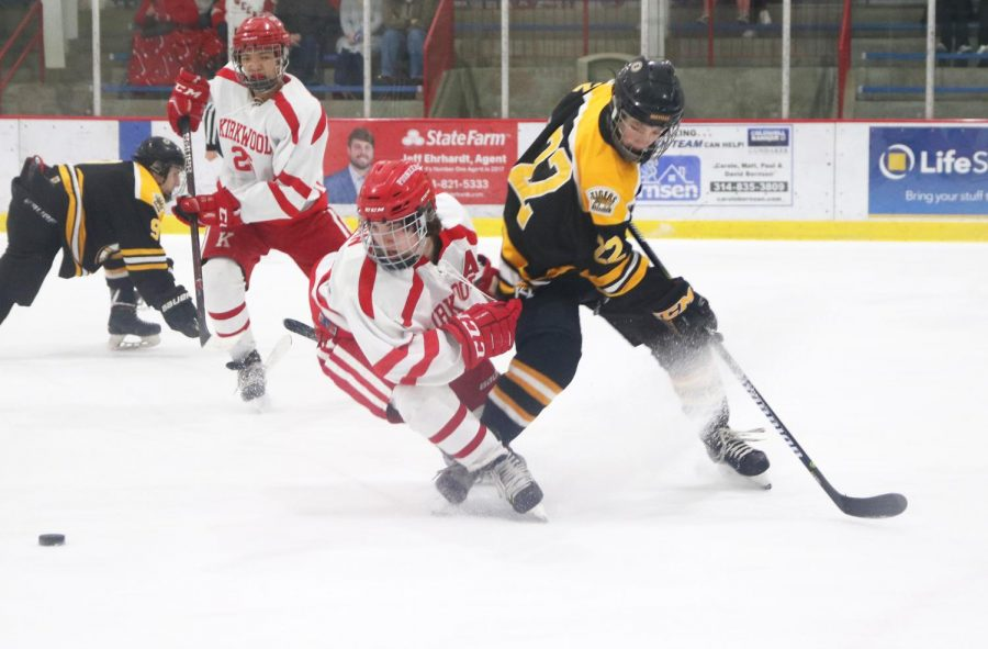 Focused on the puck, sophomore, Sarah Morgan plays in the JV hockey game against Oakville High School Jan. 7