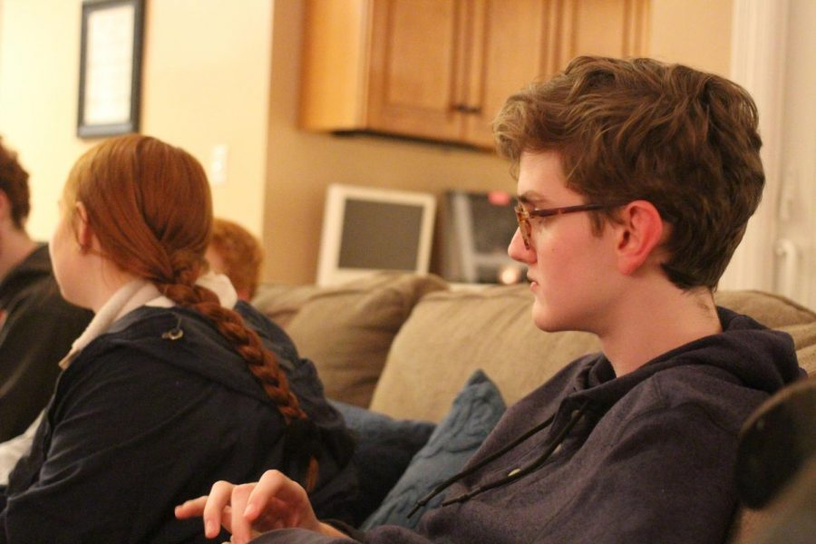 Deep in thought, Christopher Plants, sophomore, listens to other FCA members discuss their faith, Jan. 16.