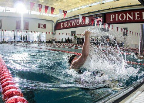 Pushing off the wall, Julie Obertop, junior, swims the 100 breast at the Kirkwood Invite Jan. 18.