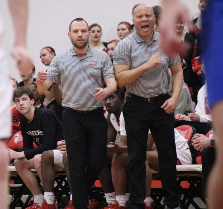 Boys basketball coaches, Mark Decker and Nelson Taylor, cheer after Kirkwood scored a point during a game on Jan. 24.