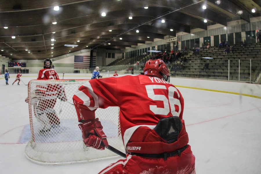 Fighting to keep the puck away from the Kirkwood goal, Griffin Young, sophomore, plays in the JV hockey game Jan 26.