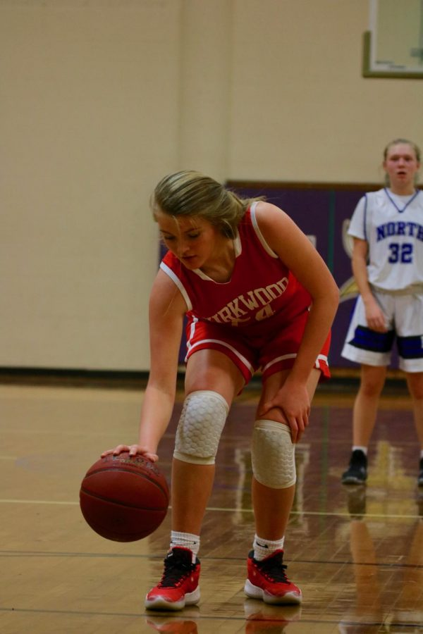 Preparing for her free throw, Caroline Puffer, dribbles the ball before shooting during a game Jan. 14.