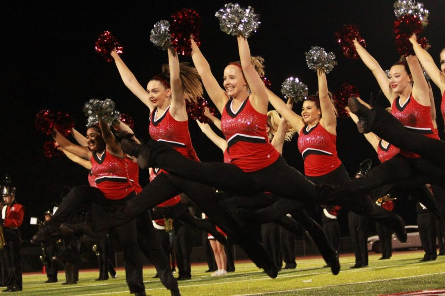During halftime, Charlotte Heinrich, senior, performs a jump in her dance Sept. 28