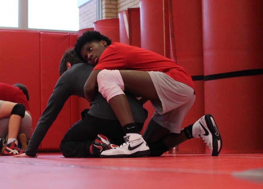 While at practice, Landry Brown, junior, wrestles a teammate in preparation for an upcoming meet.