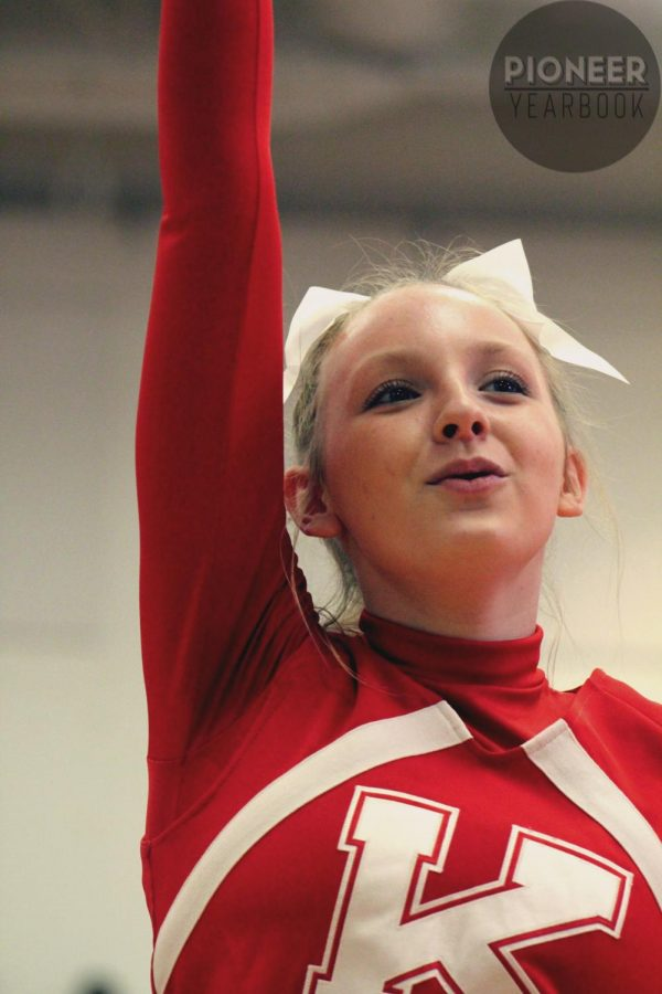 Cheering towards the crowd, Addie McCandless, freshman, performs in her first Turkey Day Pep Rally Nov. 26.