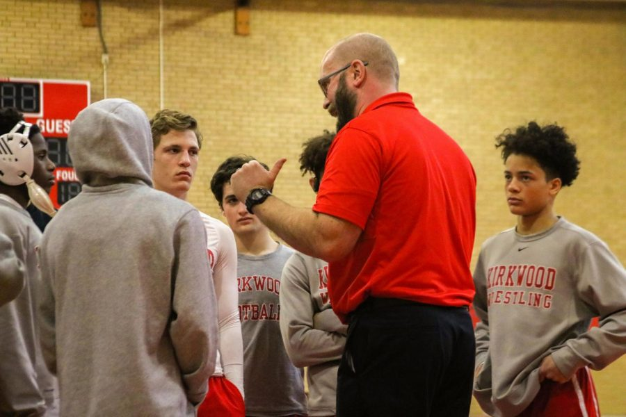 Listen carefully to their coach before the match the Kirkwood High School wrestling prepares for their match Jan. 18.