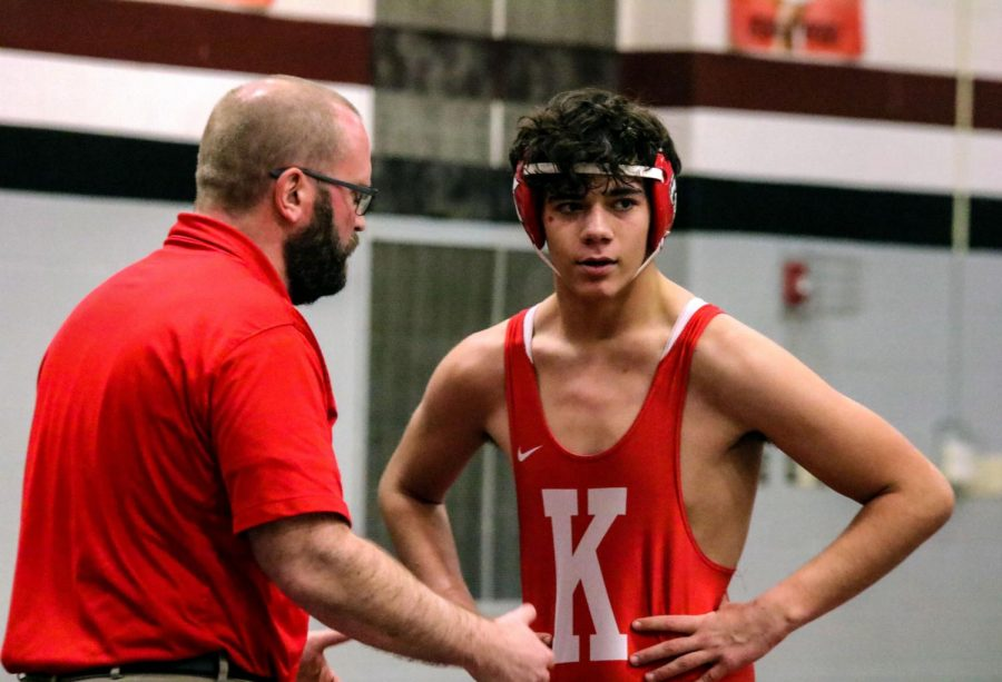 During break time, Coach Dickinson explaining strategy to Nathan Hodo, Sophomore, at Rockwood Summit high school, Jan 29th.