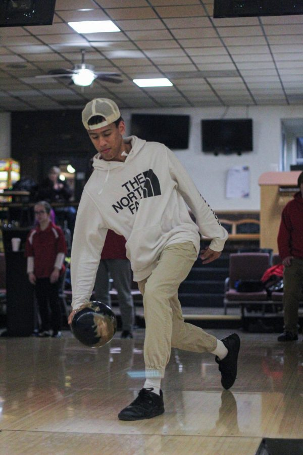 Moments before he bowls a strike, RJ Watkins, senior, sets his feet in the proper position during practice at Crestwood Bowling Alley Jan. 23.