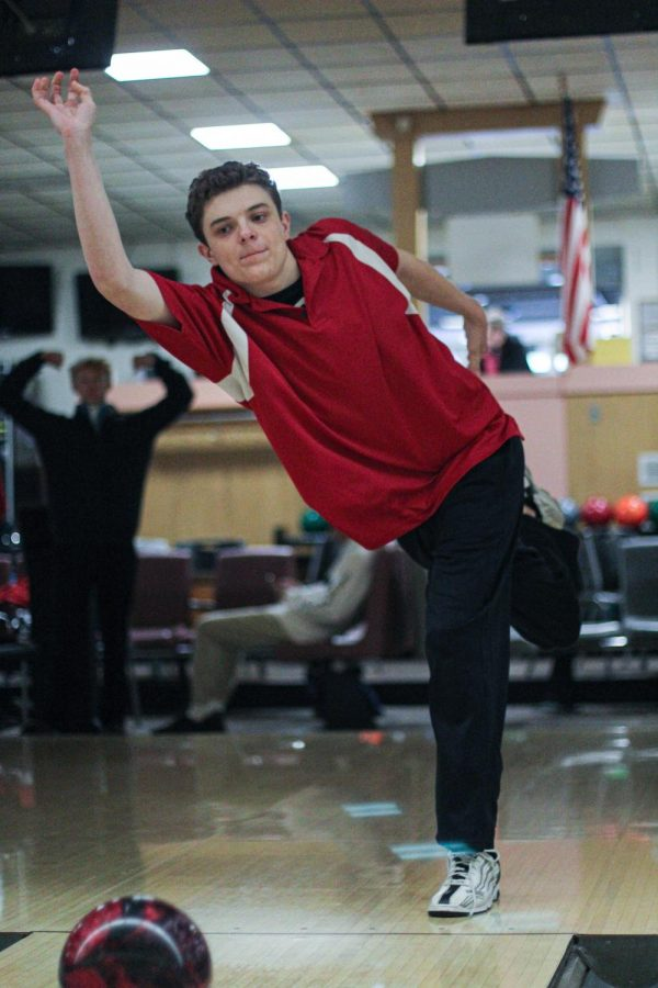 As the ball glides down the lane, Emmett Juckem, junior, holds his form after rolling the ball during practice at Crestwood Bowling Alley Jan. 23.