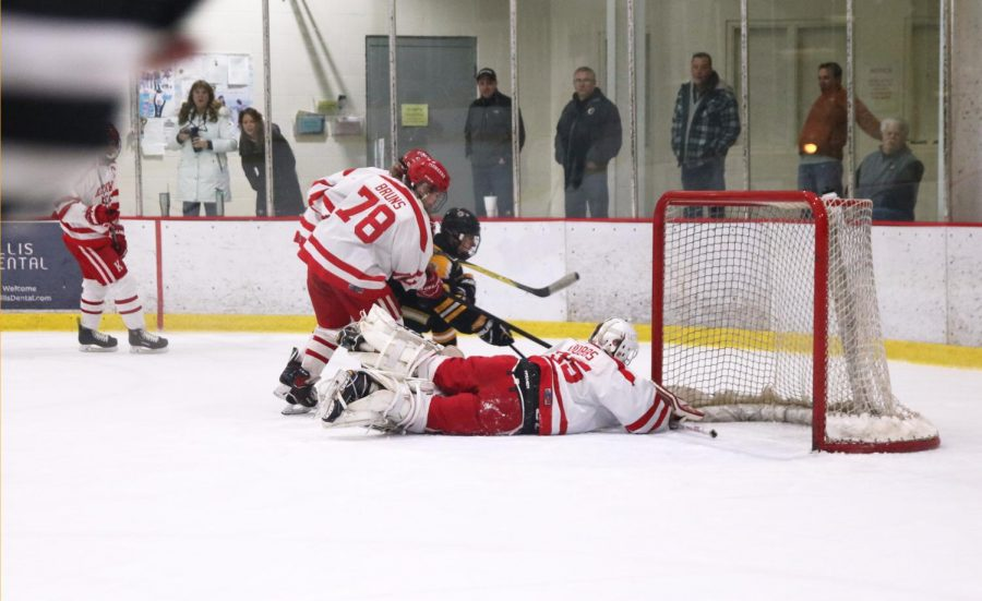 Jack Dobbs blocks a shot, during the JV hockey game Jan. 7.