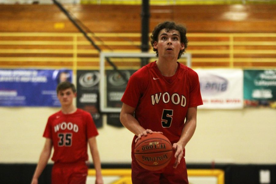 Eyes on the rim, Landon Evans, senior, gets ready to shoot a free throw after being fouled in their game against Lafayette High School Jan 10.